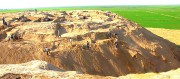Ongoing work at the Kampyr-Tepe excavationsite within the Kushan Hellenistic urban system found on the Amu Darya river bank at the Republic of Uzubekistan, Central Asia. Panoramic view into Afghanistan beyon the excavation site.